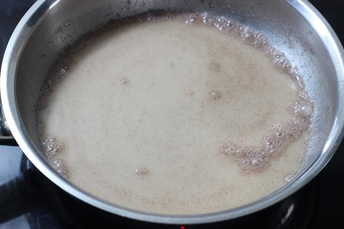 pour water and stir to make ragi porridge for babies