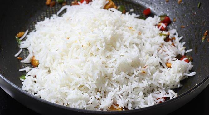 addition of rice in schezwan chicken fried rice recipe