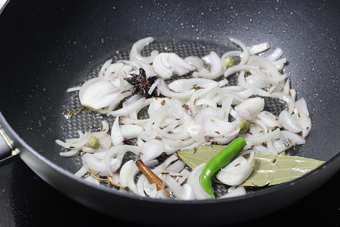 fry onions in oil to make capsicum rice recipe