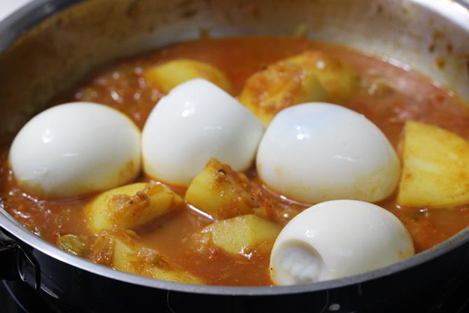 cooked potatoes addition of eggs in aloo egg curry