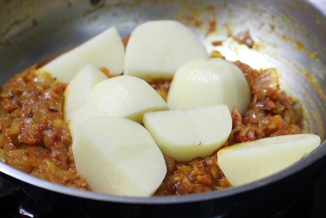 addition of aloo for potato egg curry recipe