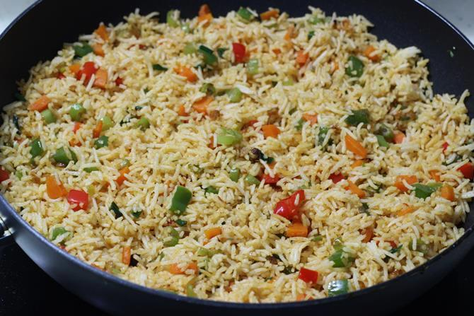 garnished restaurant style schezwan fried rice recipe