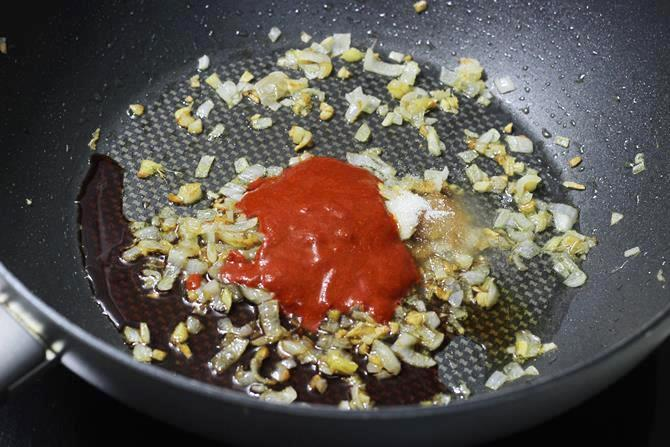 addition of sauce red chili paste to make schezwan fried rice recipe