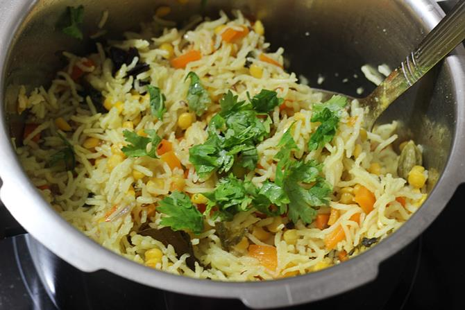 making chana dal pulao in a pressure cooker