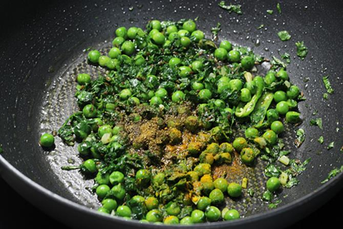 adding turmeric masala powder to make methi rice recipe