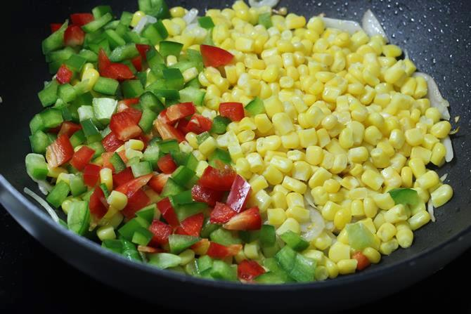 addition of veggies to the pan to make sweet corn fried rice
