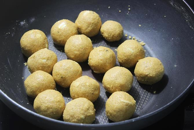 rolling shaping mixture to besan ladoo
