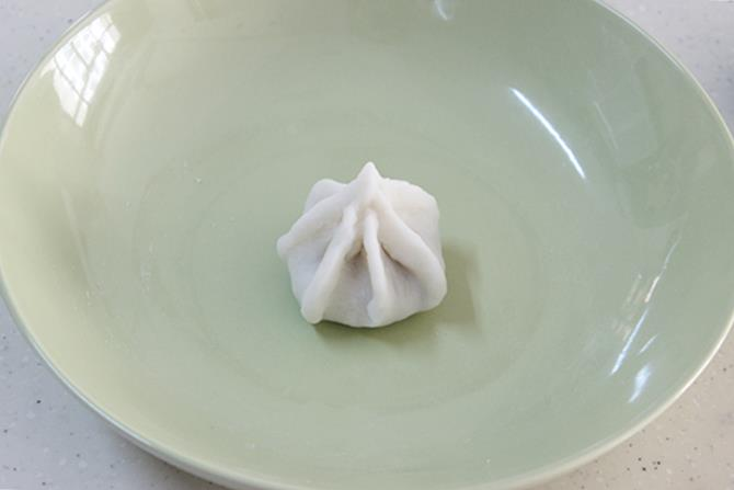 joining pleats on cup to shape modak