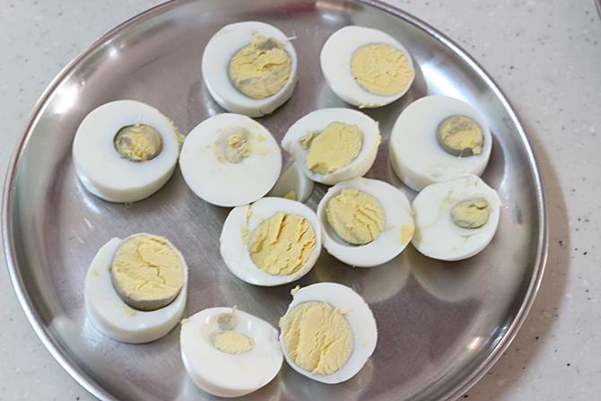 slicing boiled eggs to make egg pakora recipe