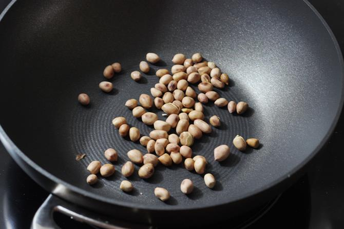 roasting peanuts in skillet for mirchi ka salan recipe