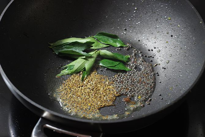 tempering cumin mustard to make mirchi ka salan recipe