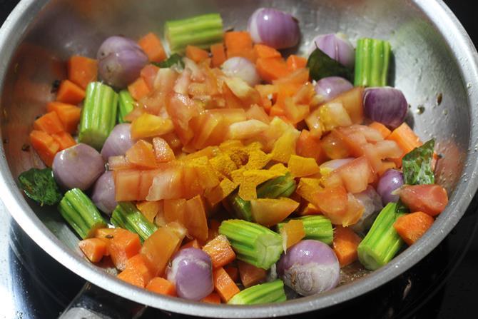 addition of tomatoes to make sambar rice