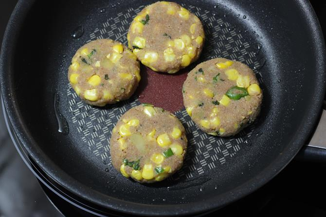 frying patties on pan