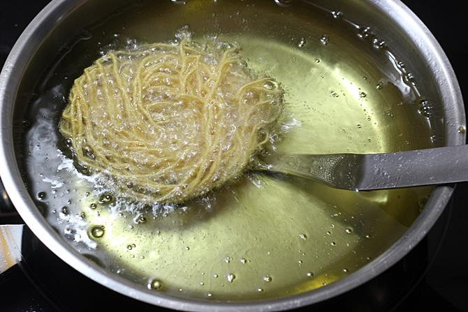 Dip the ladle in the hot oil