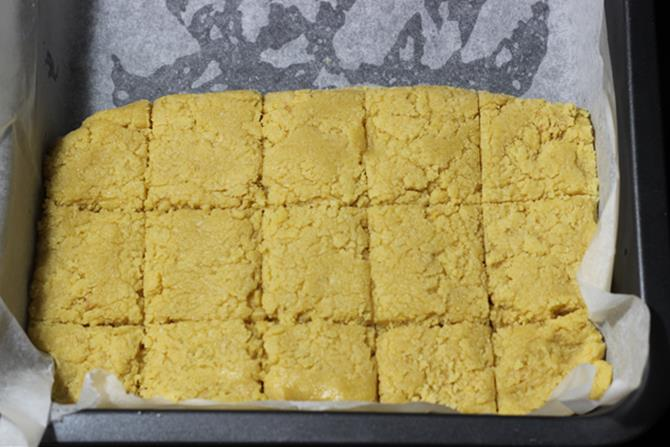 7 cups burfi mixture setting in tray