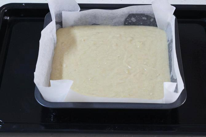 batter in greased tray for banana cake recipe