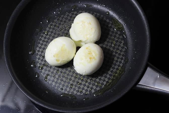frying eggs for egg butter masala