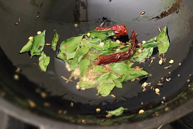 frying curry leaves for steamed cabbage curry