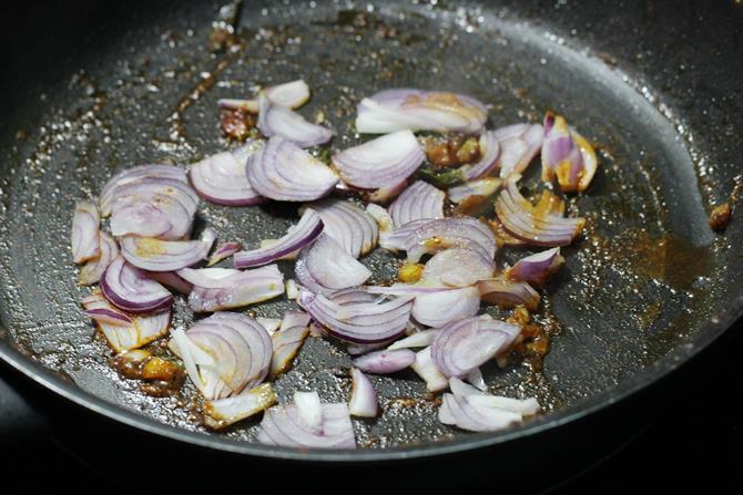 add sliced onions, slit green chili