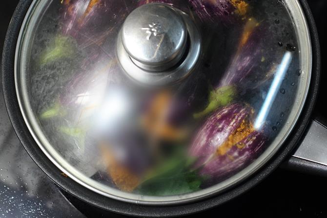 cooking gutti vankaya fry on a low flame