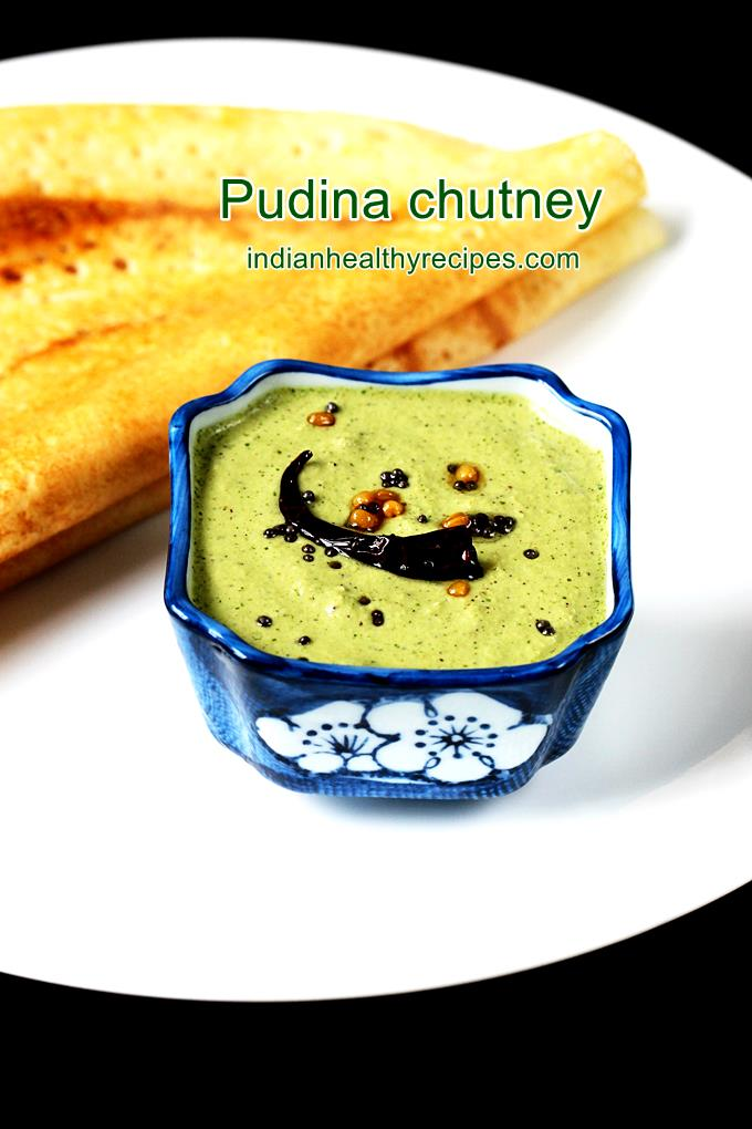 pudina chutney served in a blue bowl with dosa in a white plate