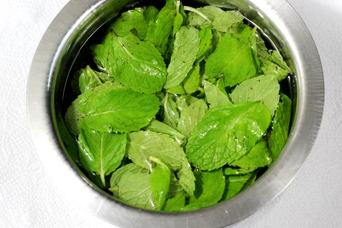washing mint leaves for pudina coconut chutney recipe