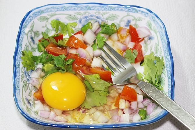 beat egg with veggies for egg toast
