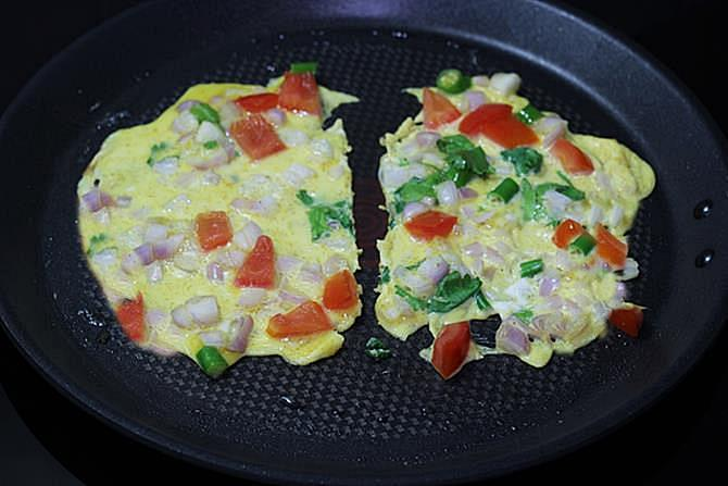 frying eggs on pan for egg toast