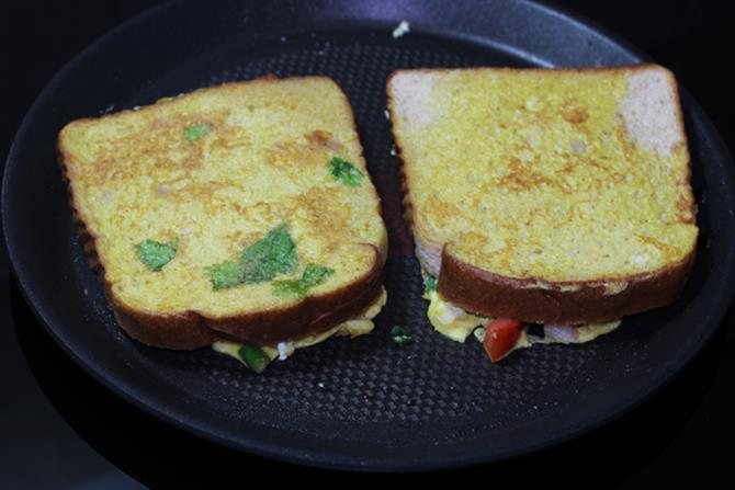press egg toast with spatula