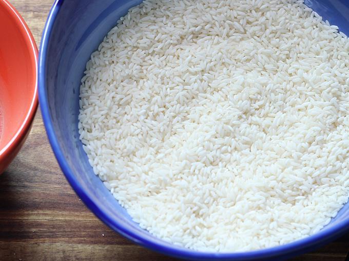 measuring rice to soak for masala dosa