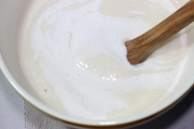 mixing rice dal batter to make masala dosa