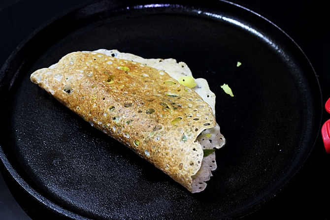 Allow the dosa to toast till golden and crisp