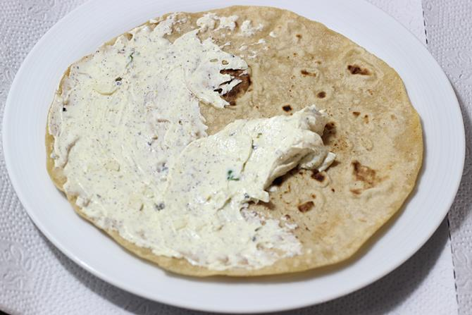 Smear the prepared spread over the roti including edges