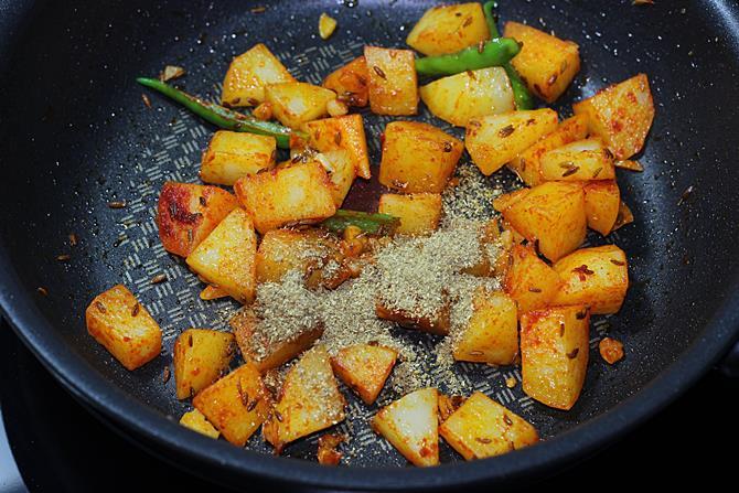 Add coriander powder or garam masala