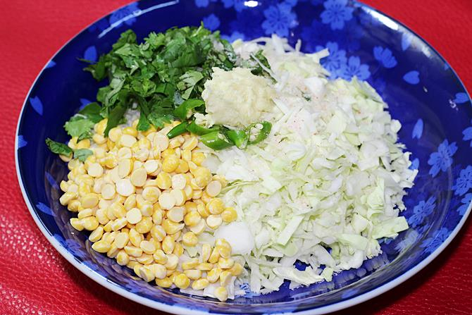 add ingredients to bowl to make cabbage vada