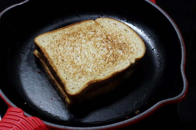 making cheese sandwich on griddle
