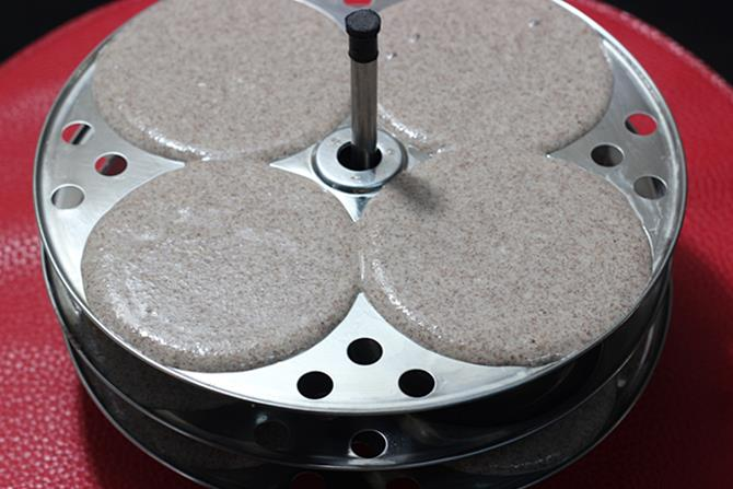 grease and pour the batter to idli plates