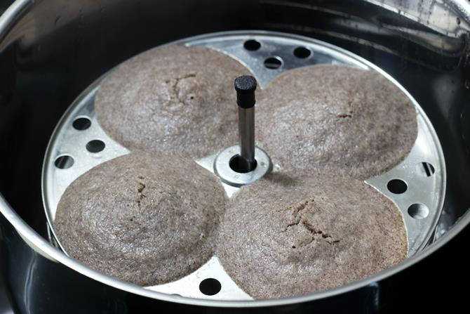 place the idli stand in the steamer