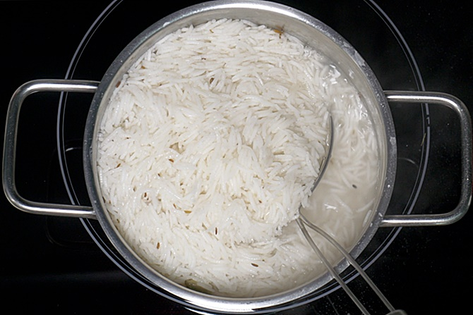 draining cooked biryani rice