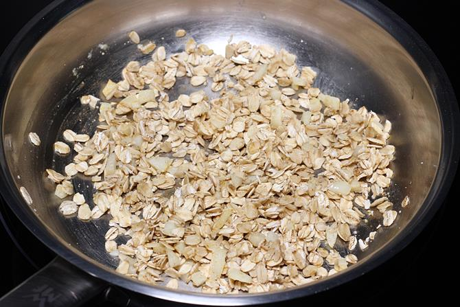 adding oats to make soup