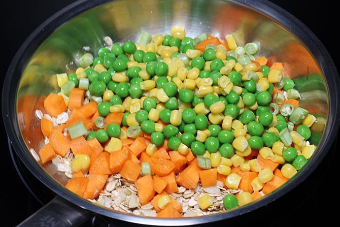 adding veggies to pan