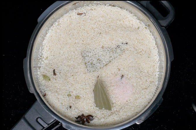 Add drained rice
