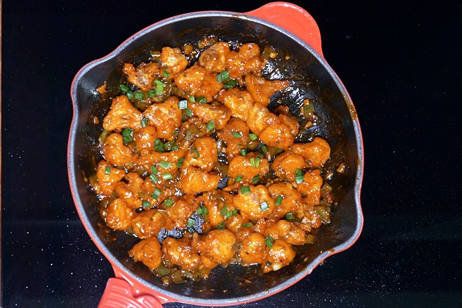 Garnish gobi manchurian with spring onions