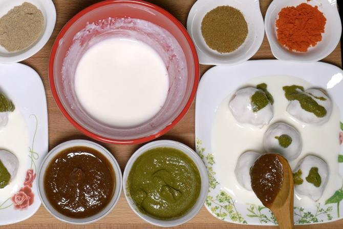 adding sweet sour and hot chutney over dahi vada