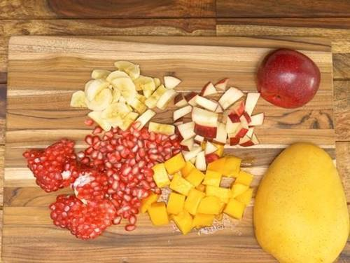 chop chilled fruits to make fruit custard recipe