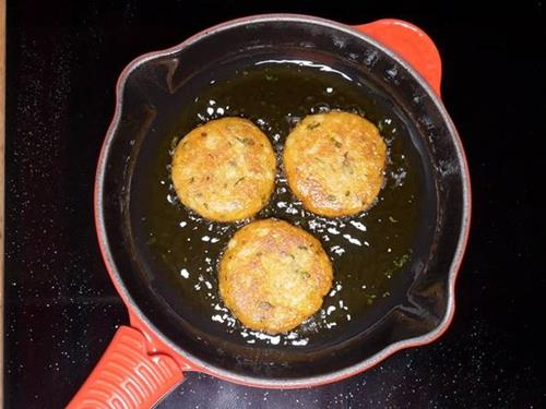 frying aloo tikki until crisp