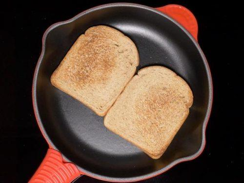 toasting bread to make bread upma