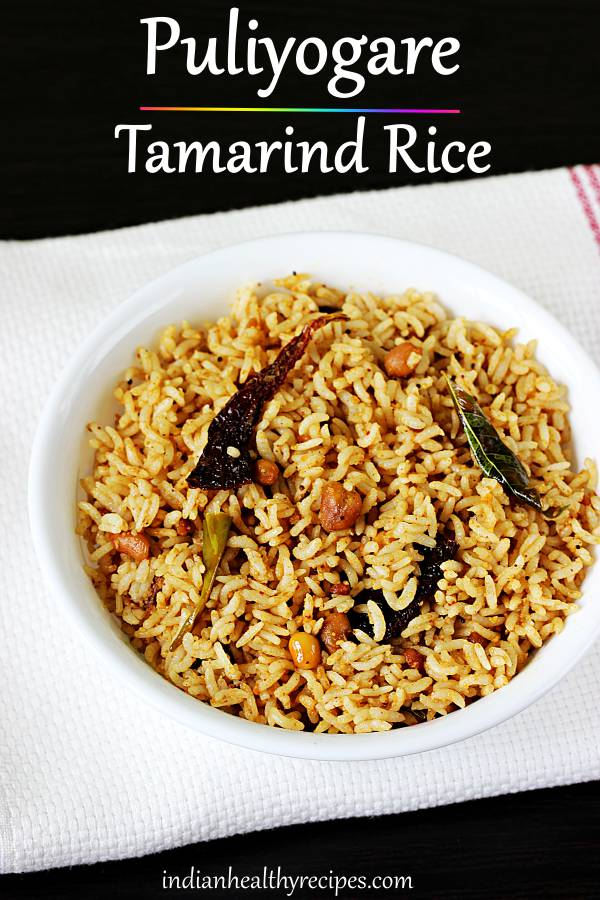 Puliyogare is south Indian style tamarind rice made with spices, tamarind, and herbs. It is slightly tangy, sweet and spicy. #puliyogare #tamarindrice