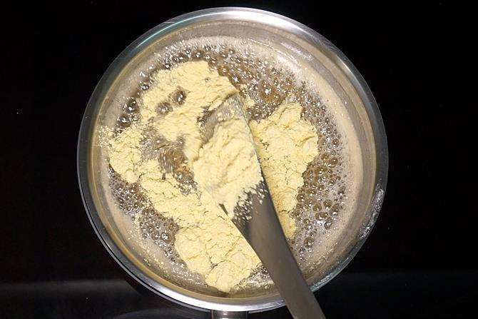 adding part of besan to syrup for mysore pak recipe