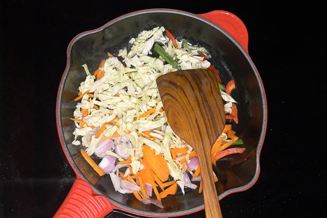 Add onions, cabbage, carrots